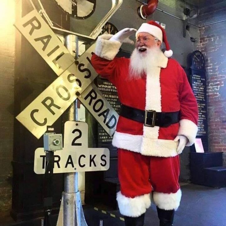 Santa by Railroad Crossing sign