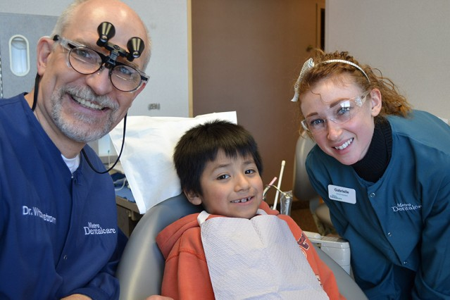 Give Kids a Smile Dental Care with Dentist, Child and Hygienist