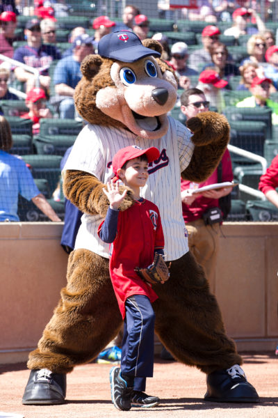 boy with T.C. Bear at Minnesota Twins game