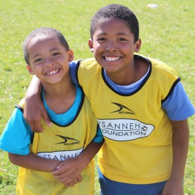 2 smiling Children participating in Free Sanneh Foundation Soccer Camp