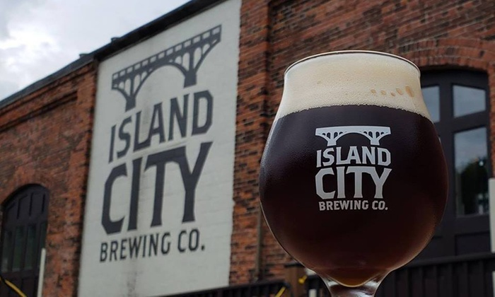 Island City Brewing Company glass mug filled with craft beer in front of building