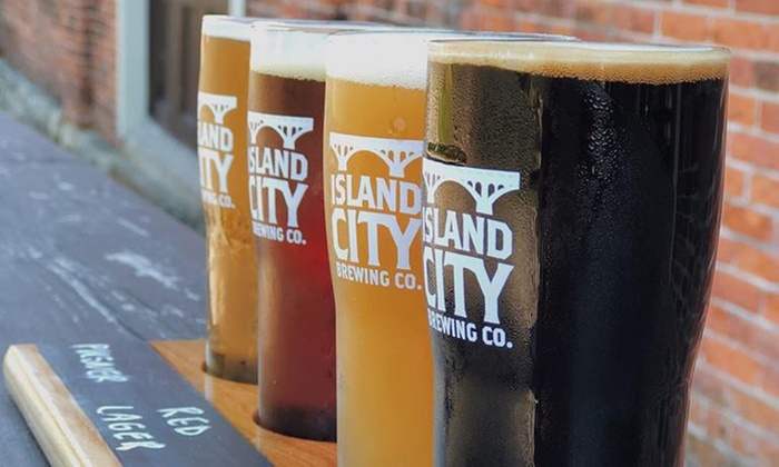 4 glasses filled with a variety of craft beer from Island City Brewing Company