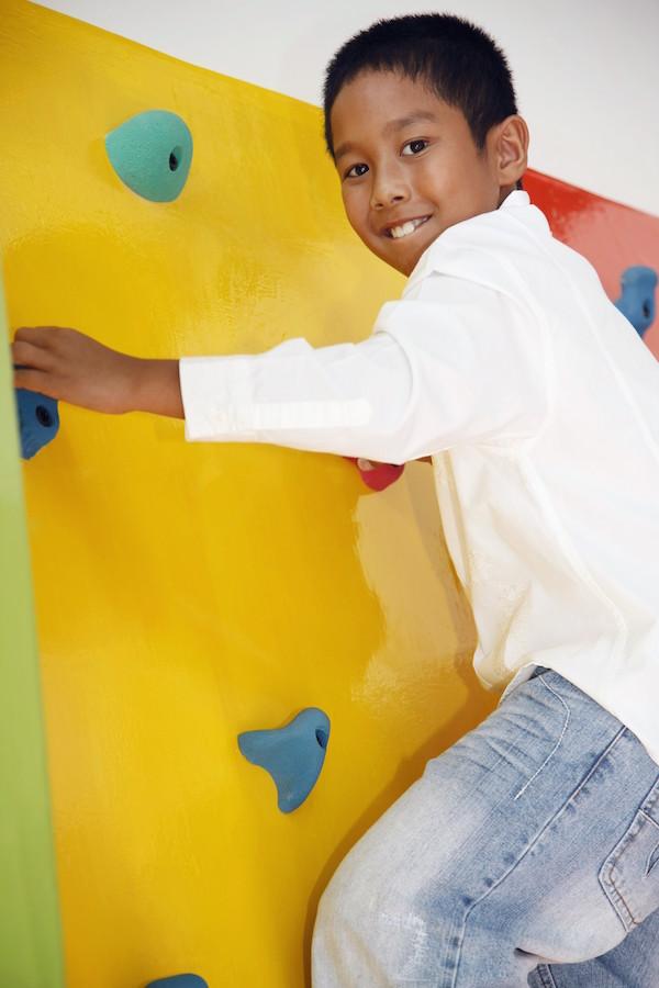Boy on Indoor Climbing Wall