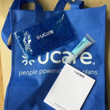 UCare goodie bag with hand sanitizer, hot/cold pack, notepad