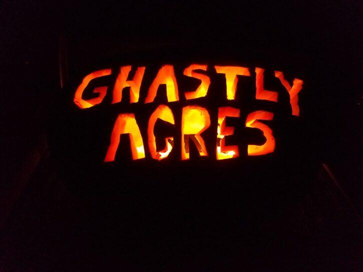 jack o lantern with ghastly acres wording