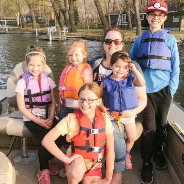 Family Fishing in Boat on Minnesota Lake