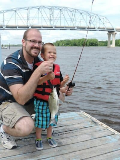 Boy and Father fishing on Mississippi River in Wabasha