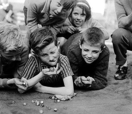 vintage photo of boys playing marbles