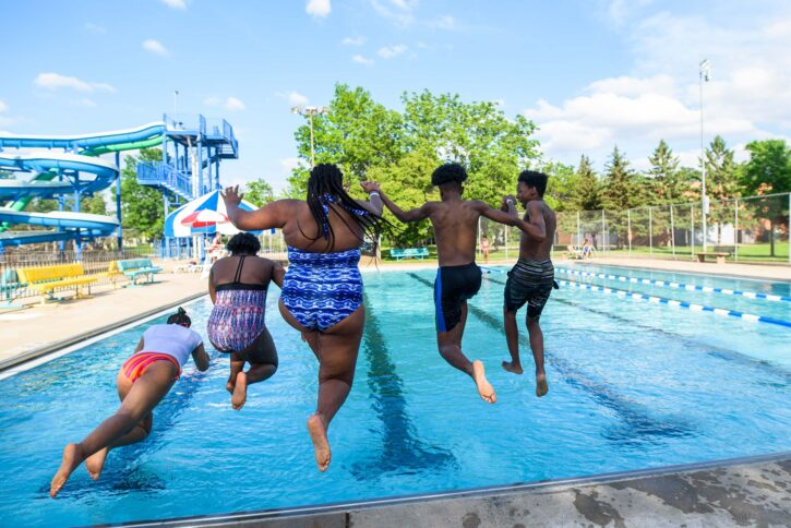 kids jumping into pool at North Commons Water Park