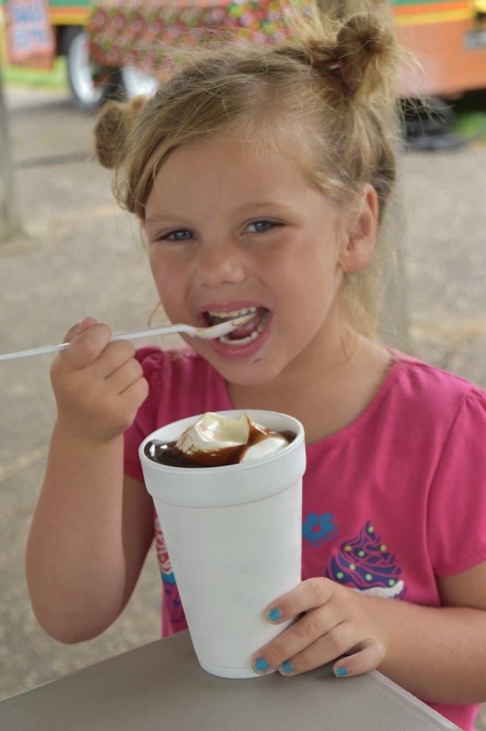 Girl eating malt at Wabasha County Fair