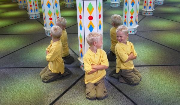 Boy playing in Amazing Mirror Maze